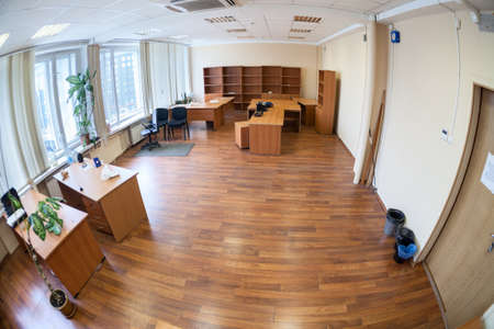 Empty office room with the remaining furniture, wide angle view 版權商用圖片
