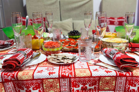 Festive Christmas table decoration, red napkin, domestic kitchen