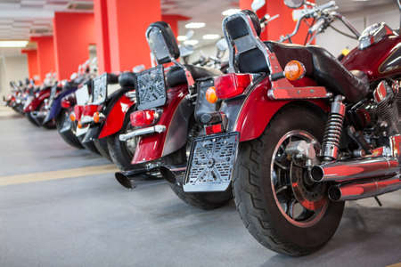 Line of top quality used motorcycles such as classic chopper is on sale. Bike shop or storage for winter laying-up and saving