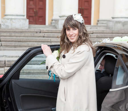 European woman getting in rear seat of luxury car with driver, vip person Standard-Bild - 119429066