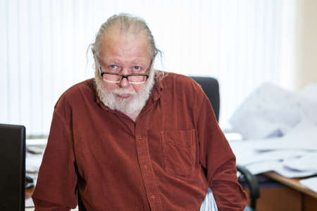 Scientist occupation senior Caucasian man with white beard and eyeglasses, looking at camera, portrait Standard-Bild - 119431570