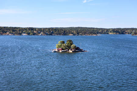 Many different building and houses are on coastline of Stockholm archipelago in Sweden. Joint valley landscape. Scandinavia, Europe