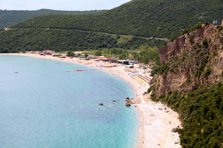 Aerial view of long coastline of Jaz Beach near Budva city, Montenegro. Balkans, Adriatic sea, Europe Standard-Bild - 121328523
