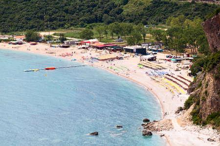 Seashore with Jaz beach in Budva municipality in Montenegro. Aerial view of coast of Adriatic sea. Balkans, Europe Standard-Bild - 121328797