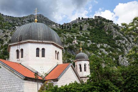 Domes with crosses of Serbian Orthodox Church in Kotor city, Balkans, Montenegro, Europe Standard-Bild - 121328799
