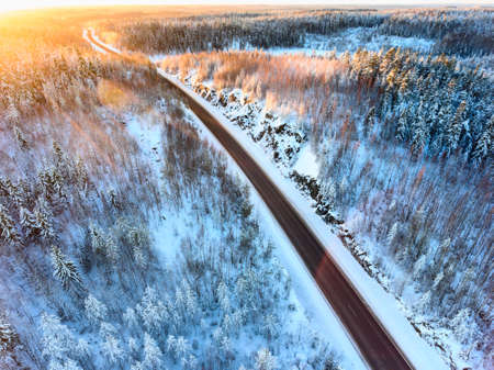 Sunset light over the Kola highway, aerial view at northern road during polar night. Karelia, Russia