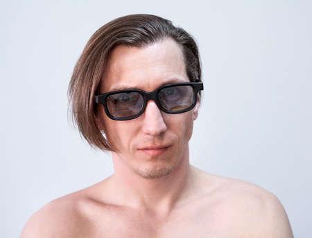 Adult Caucasian man wearing tinted glasses, torso, a long hair