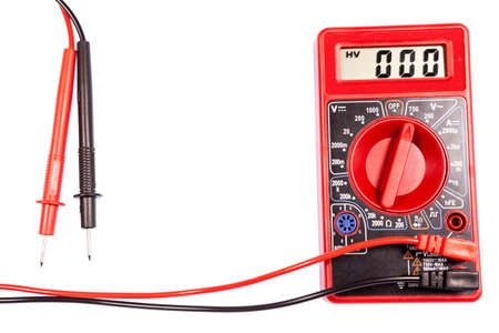 Red multimeter tester with lcd screen for measuring electrical data, isolated on a white background