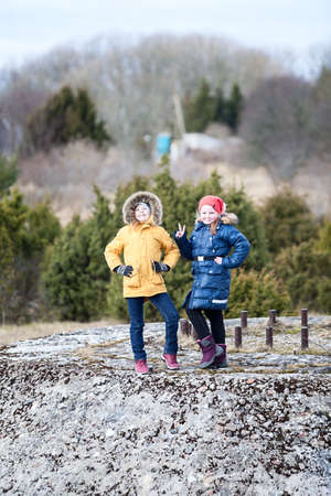 Portrait of two Caucasian young girls walking together, warm clothing at winter season 免版税图像