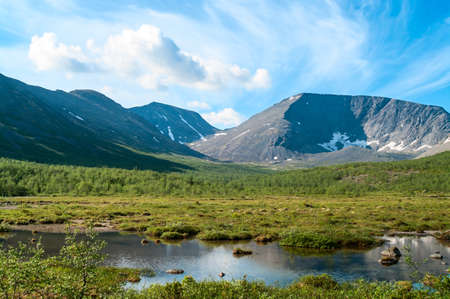 Mountain peaks and tundra at summer season. The Khibiny Massif are the highest mountains of the Kola Peninsula, north of Russia