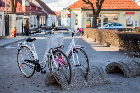 Bicycle parking station with two bikes is in the Kuressaare town at winter season, Estonia