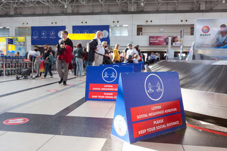 Antalya, Turkey-circa Oct, 2020: Separating boards are in luggage area in the Antalya International airport. Signs with notification about keeping social distance during Covid-19 pandemic