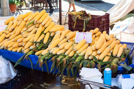Row corn cobs are on sale in stall. Fruit and vegetable marketplace is in the Alanya, Turkey
