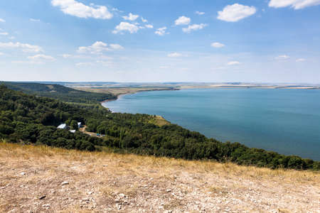 Hills and shore of the Aslikul lake with children summer camp. View from above. The Republic of Bashkortostan, Russia