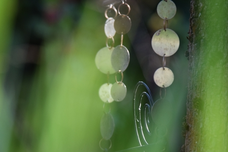 Wind chimes made of metal in the garden Stock Photo