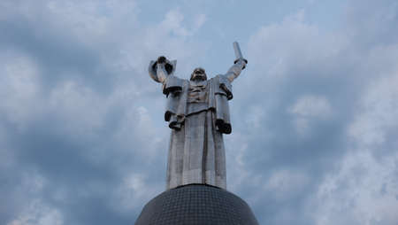 Kyiv / Ukraine - August 1, 2017: Motherland (rear view) against the background of the cloudy sky. Opened in 1981. The author of the monument is the sculptor VZ Borodai.