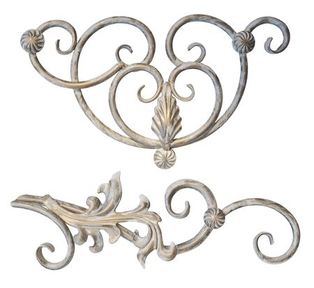 forged element of steel covered with Golden paint with curls, bends and plant elements for gates and doors,image on a white background isolated Stock fotó
