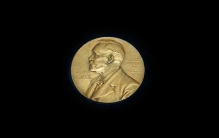 The medal is awarded annually to the prestigious international Nobel prize. Gold medal on black background
