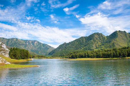 A beautiful lake with mountains in the background. Reservoir Chemal hydroelectric power station