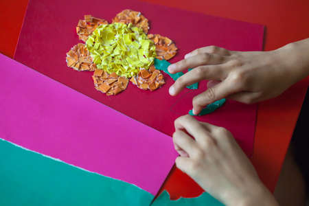 Childs Hands Made Crafts From Colored Paper The Child Is Applique