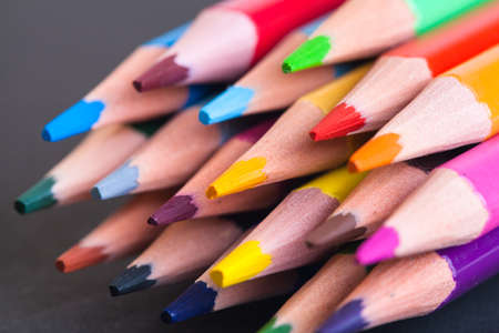 Colored pencils on the whole picture. Bright colored pencils. Colored pencils macro.