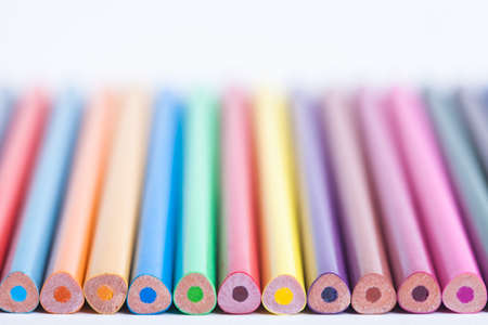 Bright colored pencils in a blurred form. The image is blurred. Background of colored pencils. Selective focus. A place for a label.