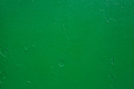 The green background. Painted metal surface. Metal painted green. Iron plates welded together