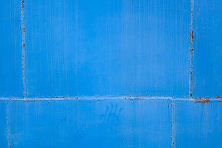 Blue background. Painted metal surface. Metal painted in blue color.