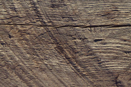 The marks on the tree from the circular saw. The baсkground of the tree for text. The texture of the old burnt wood with multiple damage and cracks. Artificially aged boards. 스톡 콘텐츠