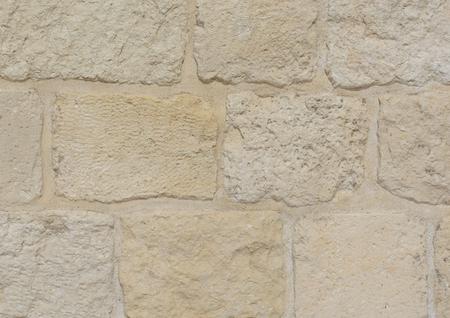 Light beige stone blocks of an ancient wall