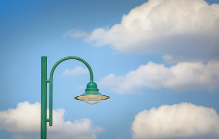 Green simple lamp in the afternoon against the background of the sky Banco de Imagens