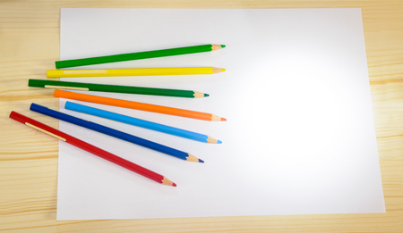 Colored pencils on the clean sheet of paper Stock Photo