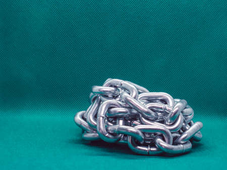 Large chain folded in a pile on the background
