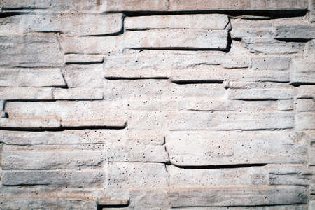 Stone decorative wall of gray color in the sunlight 스톡 콘텐츠