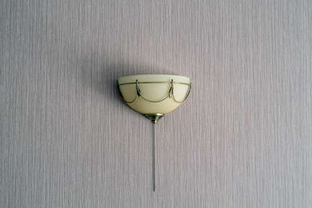 semicircular wall light with a gold frame and decorative elements