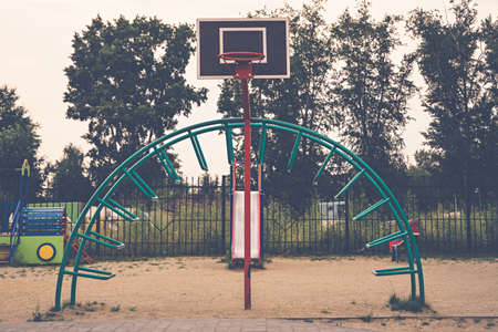 Children's round rotary swing in the playground outdoor close-up.