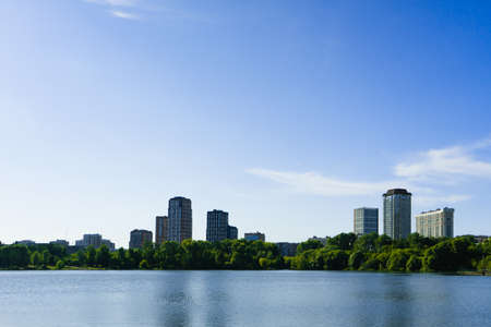 view of tall houses in a cityscape across a body of water Imagens