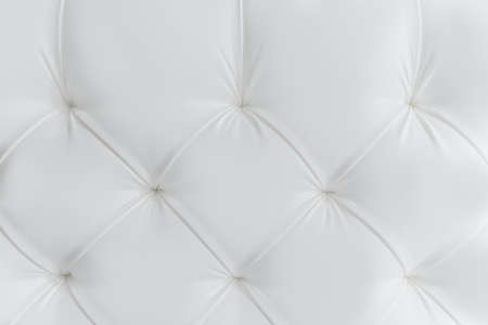 White leather upholstery with carriage