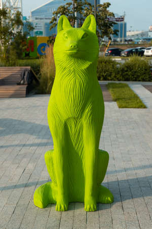 wolf figure made of colored plastic outdoors in the park Imagens