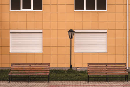 two Light blue wooden bench and wooden wall. Imagens