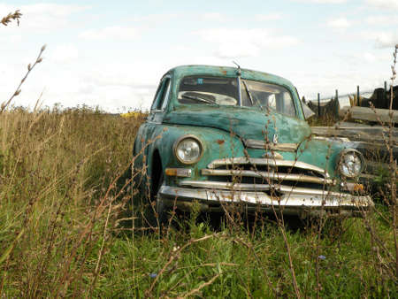The old abandoned vintage car in field turquoise