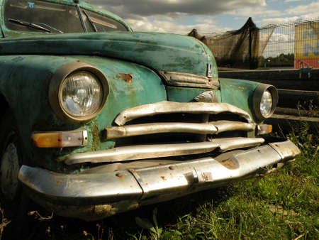 rusty car: The old abandoned vintage car in field turquoise
