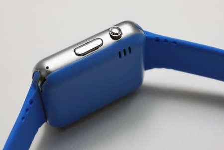 Smart watch with blue strap closeup on white background