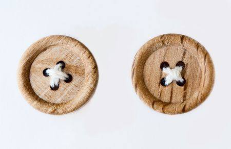 Two Wooden Sewed Buttons isolated on white background