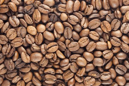 Closeup of Roasted coffee beans - decorative background photo
