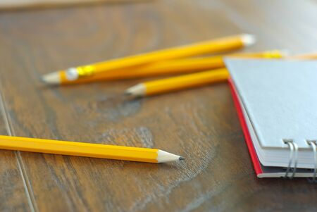 Drawing pencil with notebook on desk table working place. Idea memories reminder concept. Personal notepaper kit. Stock Photo