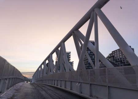 Pink sunset on a pedestrian bridge. Winter,An element of a modern pedestrian bridge. Deserted.