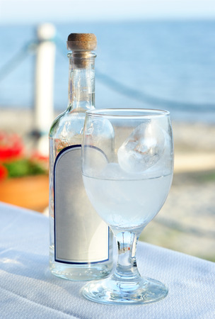 Traditional greek ouzo with ice cubes