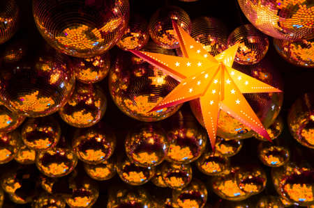 nightclub party: Nightclub gold disco balls and glowing yellow star in colorful festive lights in dance club