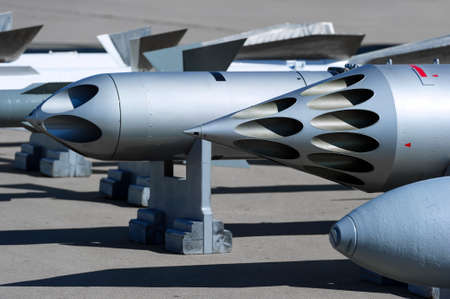 modern fighter: Missiles, bombs, rocket launcher and other guided and unguided armament of fighter jet, modern weapon of aircraft, military industry, selective focus Stock Photo